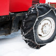 Snow chains on truck wheel - Stock Photo