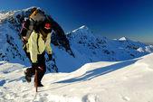 Climbing alpinist — Stock Photo