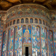 Voronet Monastery painted wall, Unesco Heritage, Moldavia, Romania - Stock Photo