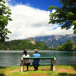 Couple enjoying the Bled Lake scenery — Stock Photo