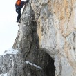 Stock Photo: Alpinist climbing