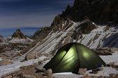 Illuminated green alpine tent — Stock Photo
