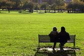 Couple on bench — Stock Photo