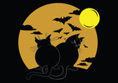 Two black cats with bats and moon — Stock Vector