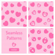 Set of pink seamless patterns with hearts. — Stock Vector #31600659