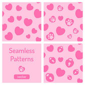 Set of pink seamless patterns with hearts. — Stock Vector
