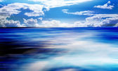 Cloudy blue sky and sea surface great for background — Stock Photo