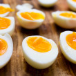 Hard boiled eggs, sliced in halves — Stock Photo