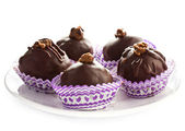 Delicious assorted dark chocolate truffle candies on a white pla — Stock Photo