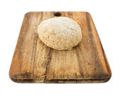 Raw ball of dough on wooden board isolated on white — Stock Photo