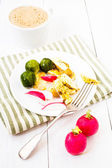 Healthy fresh Breakfast with fried cutted egg, brussels sprouts, radish and coffee with milk on white wooden background — Stock Photo