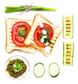 Sandwich ingredients for breakfast with pesto, bread, vegetable — Stock Photo