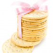 Cookies with pink ribbon isolated on white background, closeup — Stock Photo