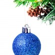 Christmas shiny blue ball on fir branches with decorations  — Stock Photo