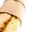 French baguette bread  on white background, macro — Stock Photo