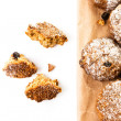 Stock Photo: Pile of chocolate chips small cookies on brown paper parchament on white background.
