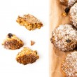 Pile of chocolate chips small cookies on brown paper parchament on white background. — Stock Photo