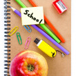Back to school supplies with Notebook, red apple and pencil. — Stock Photo