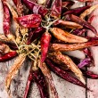 Dried red hot chilli pepper on dark wooden background — Stock Photo #29600747