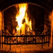 Home Fire burning in the fireplace. Seasonal and holiday fire. — Stock Photo