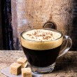 Stock Photo: Frothy Cup of Espresso coffee with cane sugar topped with sprinkled chocolate