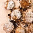 Pile of small cookies on brown paper parchament background. — Stock Photo