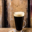 Black coffee in a Latte Glass and sugar on old wooden vintage table or grunge wood background. — Stock Photo #29601529