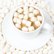 Cup of hot chocolate  with  many plump Fluffy mini marchmallows. — Stock Photo