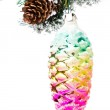 Christmas shiny colorful cone on fir branches with snow decorations — Stock Photo #29601585