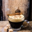 Frothy Cup of Espresso  coffee  on rustic brutal dark wooden  background — Stock Photo
