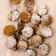 Stock Photo: Pile of small cookies on brown paper parchment background