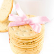 Cookies with pink ribbon and tea cup isolated on white background — ストック写真