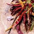 Dried red hot chilli pepper on dark vintage wooden background. — Stock Photo #29602123