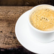 Closeup cup of espresso on old wooden table over grunge background — Stock Photo #29608239