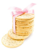 Cookies with pink ribbon isolated on white background — 图库照片