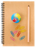 School supplies with Globe, clip and notebook on white background — Stock Photo