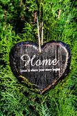 Heart shaped decor sign desk Home country style on green plant — Stock Photo