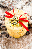 Christmas cookies with red ribbon and knitted winter mitten. — Stock Photo