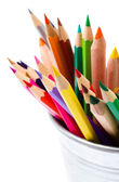 Color pencils in tin can or pencil holders — Stock Photo