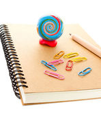 School supplies with art Globe, clip and notebook on white background — Stock Photo