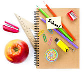 School supplies with Globe, apple, pencils and notebook on white background. — Stock Photo