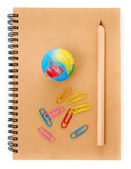 School supplies with Globe, clip and notebook on white background. — Stock Photo
