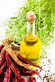 Olive oil bottle, herbs and Red hot chili pepper on white background — Stock Photo