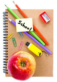 Back to school supplies with Notebook, red apple and pencil on white background. — Stock Photo