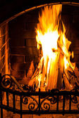 Home Fire burning in brick fireplace. Seasonal and holiday fire. — Stock Photo