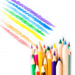 Stock Photo: Many different colored Rainbow pencils school supplies on white