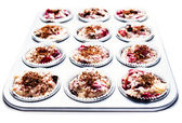 Chocolate and cherry muffin batter in a non-stick muffin tin, is — Stock Photo