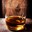 Glass of Scotch whiskey on old wooden background. — Stock Photo