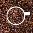 Stock Photo: White cup full of coffee beans on Roasted Coffee Beans