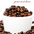 White cup full of coffee beans — Stock Photo #31299551